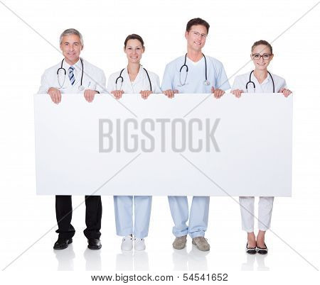 Medical Staff Holding Up A White Banner
