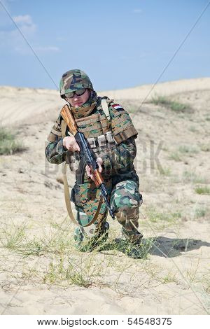 soldier with AK rifle