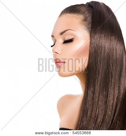 Beauty Fashion Model Girl with Long Healthy Brown Hair and Long Eyelashes. Beautiful Face. Isolated on a White Background. Ponytail Hair style. Vogue Style Woman