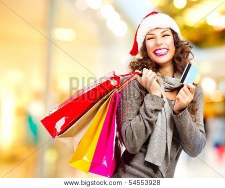 Christmas Shopping. Beautiful Happy Girl With Credit Card and Shopping Bags. Shopping Mall. Shopping Center. Christmas Sales