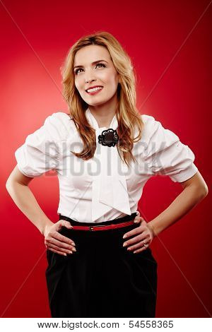 Cheerful Attractive Blonde Over Red Background