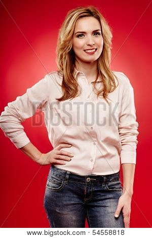 Beautiful Blonde Wearing Jeans And Shirt With Hand On Hip