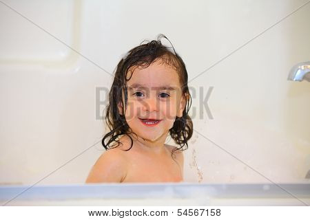 Baby Taking A Bubble Bath Smiling