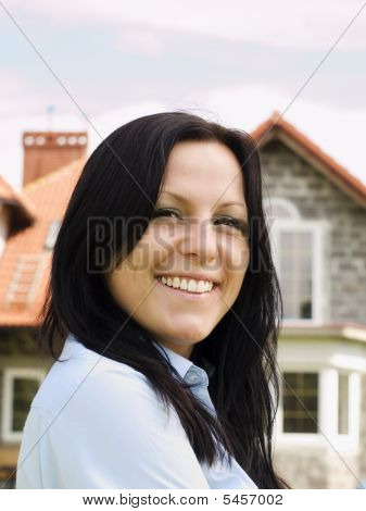 Smiling Woman And House In The Background