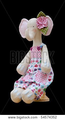 Hand Made Soft Toy Elephant Isolated In A Jumpsuit Sits