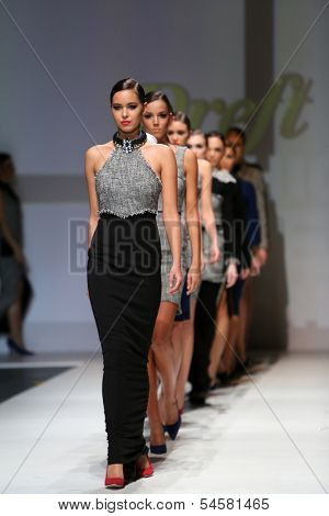 ZAGREB, CROATIA - NOVEMBER 23: Fashion models wearing clothes designed by Marija Cvitanovic on the Zagreb Fashion Week show on November 23, 2013 in Zagreb, Croatia.