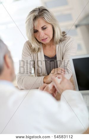 Patient consulting doctor for wrist pain