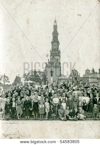 CZESTOCHOWA, POLAND - CIRCA FORTIES: Vintage photo of big group of pilgrims in front of Sanctuary of the Black Madonna and Pauline Monastery, located on Jasna Gora, Czestochowa, Poland, circa forties