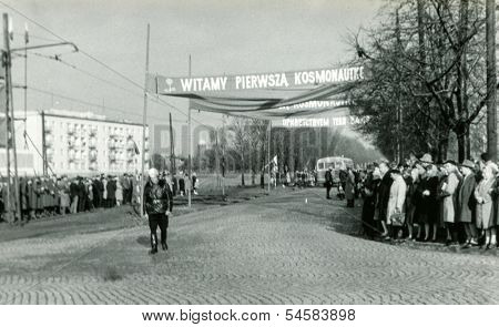 LODZ, POLAND - OCTOBER 24: crowds gather to see the first woman cosmonaut in space Valentina Tereshkova. Banners mean