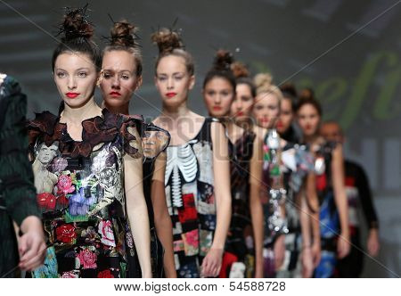 ZAGREB, CROATIA - NOVEMBER 22: Fashion models wearing clothes designed by Ana Kujundzic on the Zagreb Fashion Week show on November 22, 2013 in Zagreb, Croatia.