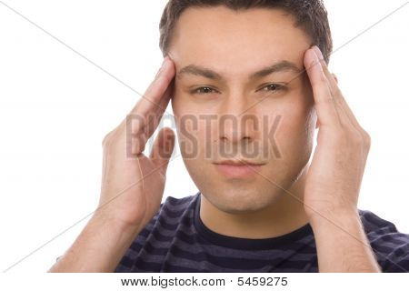 Young Man With Headache, Isolated In White Background