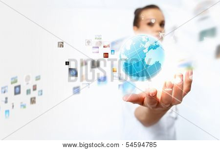 Image of globe on palm of businesswoman. Media technologies