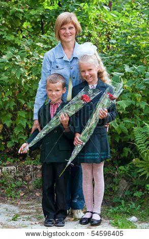 Mother With Little Schoolgirl And Schoolboy