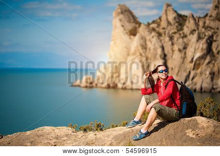 tired  tourist is resting on a mountain's top