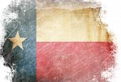 stock photo of texas state flag  - Texas flag waving in the wind with some spots and stains - JPG