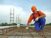 pic of bender  - Portrait of bar bender on slab steel reinforcement - JPG