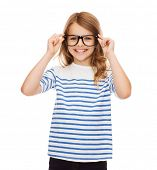 education, school and vision concept - smiling cute little girl with black eyeglasses