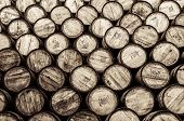 picture of malt  - Detail monochrome view of stacked wine and whisky wooden barrels and casks