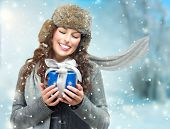 Happy Young Winter Woman With Christmas Gift. Gift Box Outdoors. Excited Girl With Holiday Present L