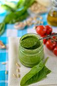 stock photo of pesto sauce  - Spinach pesto in a glass jar - JPG