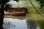stock photo of dock a pond  - Two boats on a calm lake or small river - JPG