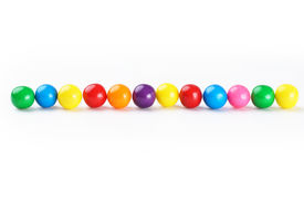 picture of gumballs  - Colorful gumballs border over white background with shadows - JPG