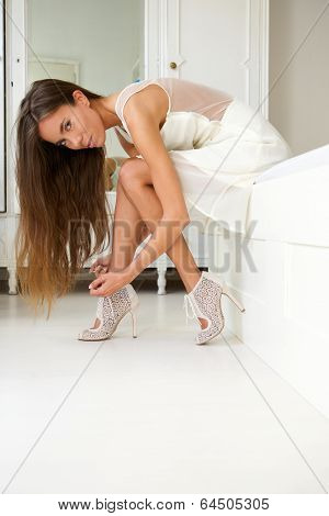 Elegant Young Woman Getting Dressed