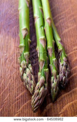 Asparagus On Wooden Table Getting Ready To Be Eaten