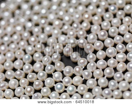 Pearl necklace beads abstract background