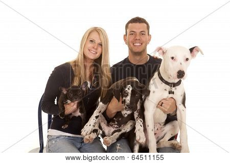 Familhy Dogs Sit Close Smile