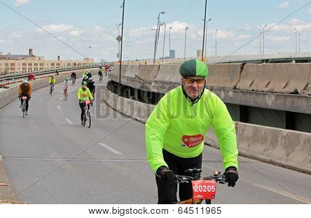 Rider in green colors on BQE