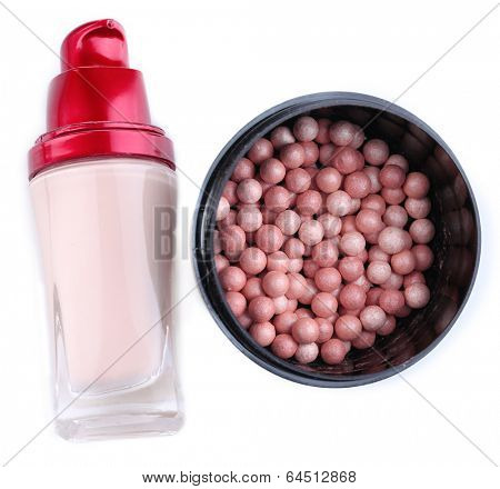 Powder balls and concealer isolated on white