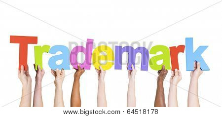 Multiethnic Group of Hands Holding Trademark