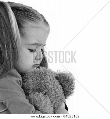 Sad Little Child Holding Teddy Bear