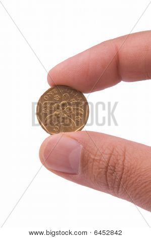 Singapore Coin Held By Two Fingers