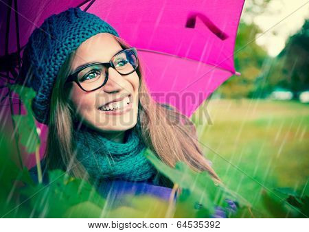 laughing girl with pink umbrella