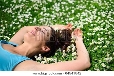 Female Athlete Resting And Relaxing On Spring