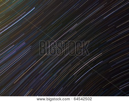 Abstract background with Orion star trails in the night sky