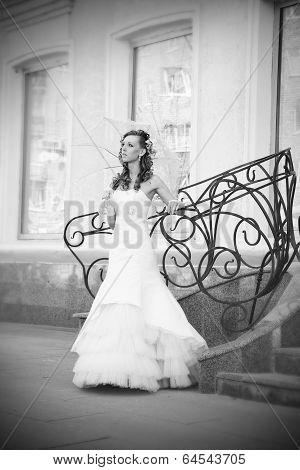 Beautiful Bride In White Dress With Umbrella