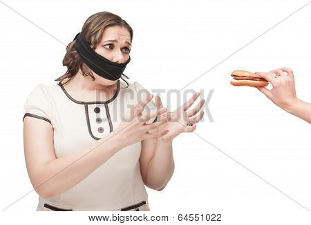 Plus Size Woman Gagged Stretching Hands To Hamburger