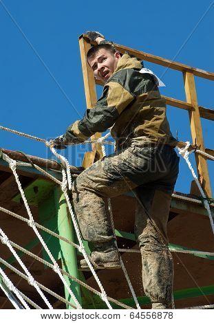man climbing on net stair