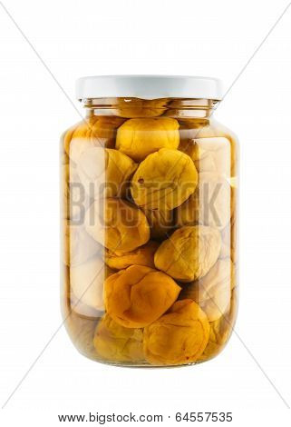 Salted Plum In Glass Jar Isolated On White Background