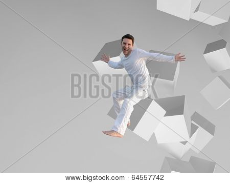 Picture of a man sitting on a white box flying in space
