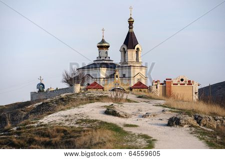 Christian Orthodox church in Old Orhei, Moldova, in rays of sunset
