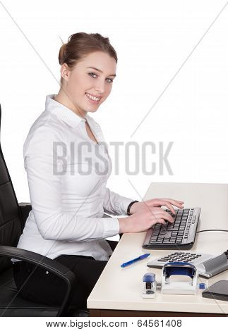 Young Woman Types At The Keyboard