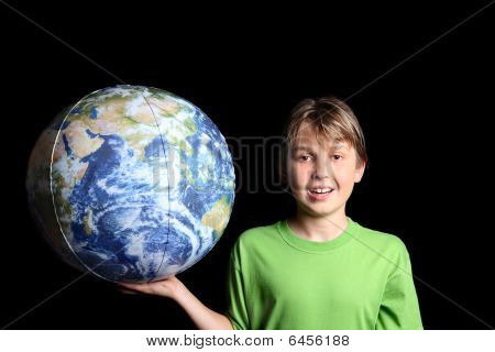 Boy Holding The Workd Earth Ball In His Hand