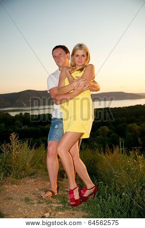 Loving Couple At Sunset In Summer