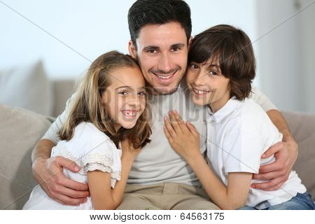 Portrait of single daddy with 2 kids at home