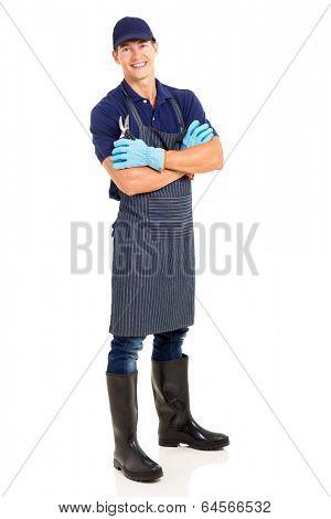 cheerful gardener holding a pruner