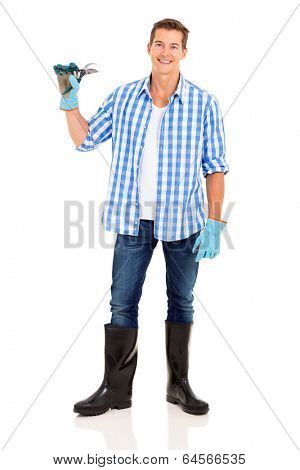 young man holding a pruner isolated on white